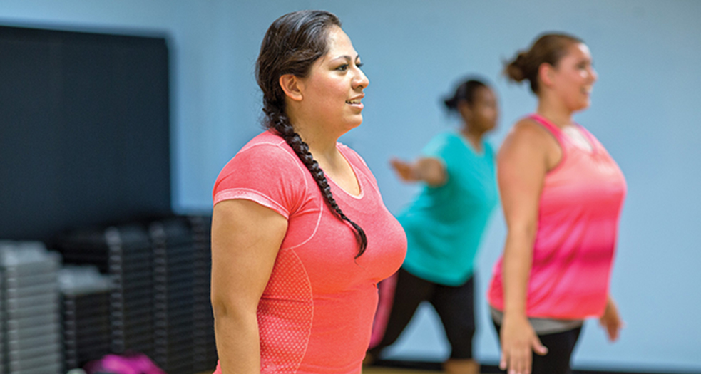 Woman wearing workout attire in a fitness class